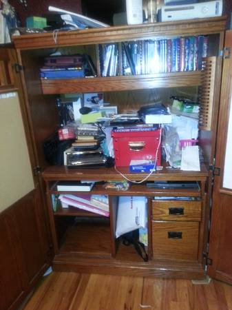 computer desk and a baige couch  (abilene)