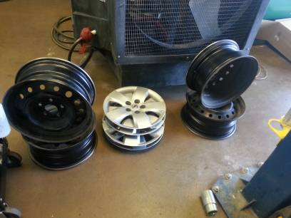 4 stock steel wheels with hub caps for 07-12 nissan altima - $100 (s.abilene)
