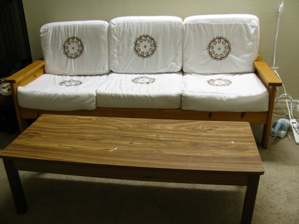 Wooden Futon (with seat cushions and covers) and Wooden Center Table - $40 (Enclave at Cedar Lodge)
