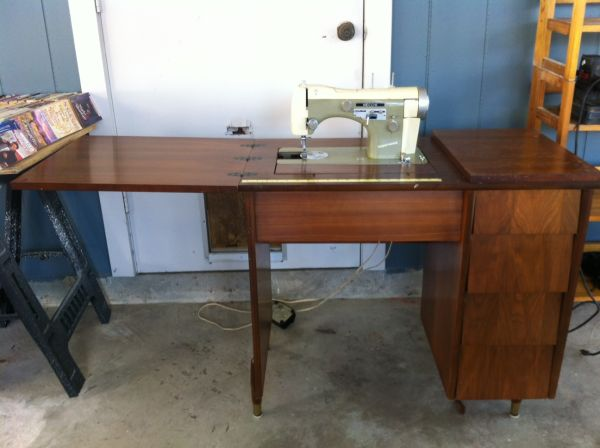 Necchi SuperNova Sewing Machine with wood cabinet - $150 (Denham Springs)