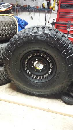 Four Goodyear Wrangler MTR MTR 37x12.5x16.5 mud tires on 8 lug steel wheels - $1100 (Denham Springs)
