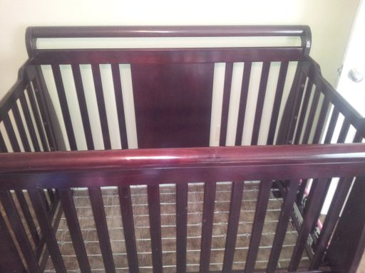 dark cherry wood crib - $300