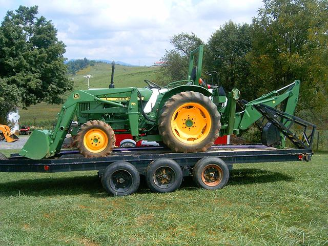 2 000  for sale John Deere 950 Tractor 4WD backhoe loader
