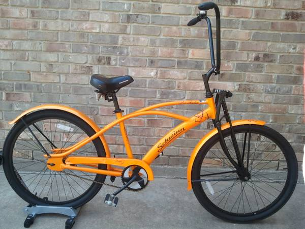 Schwinn 26 cruiser with ape hangers and pearl orange paint - $125 (Nederland)