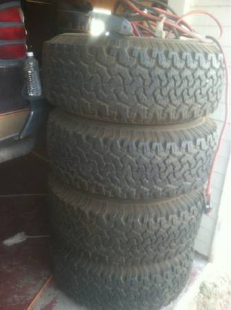 Set of 4 15x10 in rims with tires - $1000 (Midland)