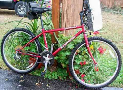 Good condition red mens schwinn 10 speed mountain bike - $85 (South Padre Island)