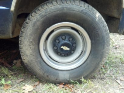set of 5 8 lug chevrolet wheels with tires - $300 (central louisiana)