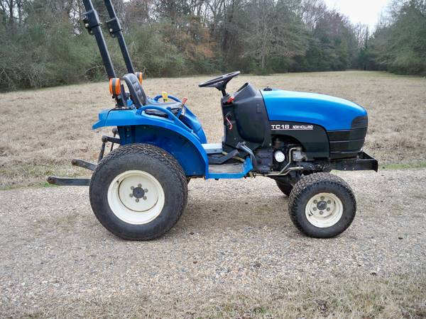 New Holland tractor - 5 HOWSE bush hog - $6800 (Keithville, LA)