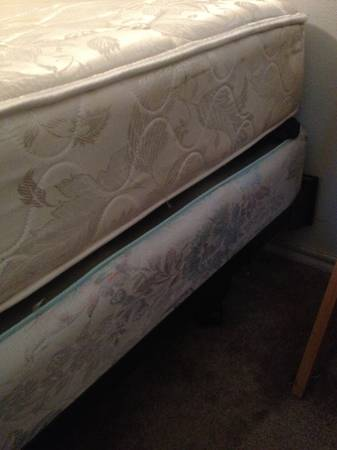 Queen size bed with egg crate top and metal frame - $150