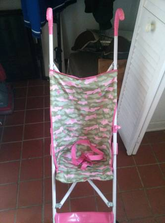 pink camo stroller and girl playmat