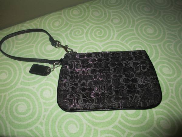 small black and silver coach wristlet -   x0024 40