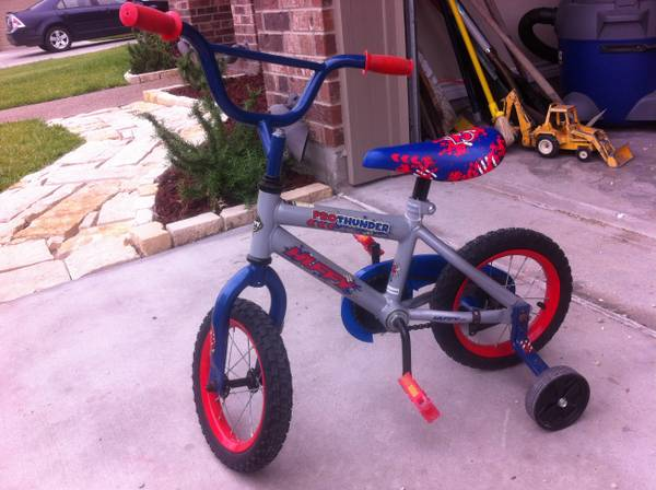 12 inch pro thunder huffy bike with training wheels - $25 (South side)