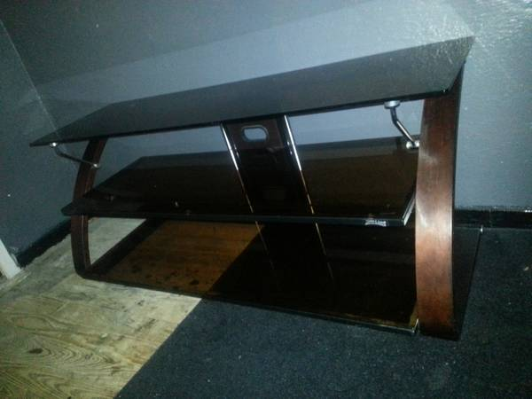 glass tv stand - $150 (cc)