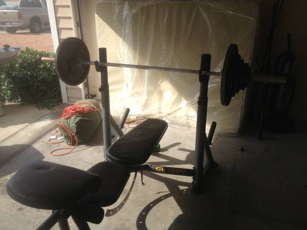 Golds gym power series weight bench and 235 lbs barbell weights  - $200 (Padre island)