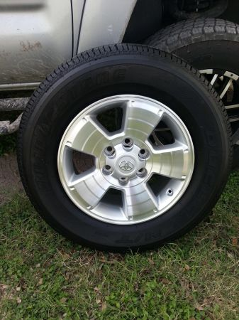 2011 Toyota Tacoma factory rims with tires - $1000 (George West, Tx.)