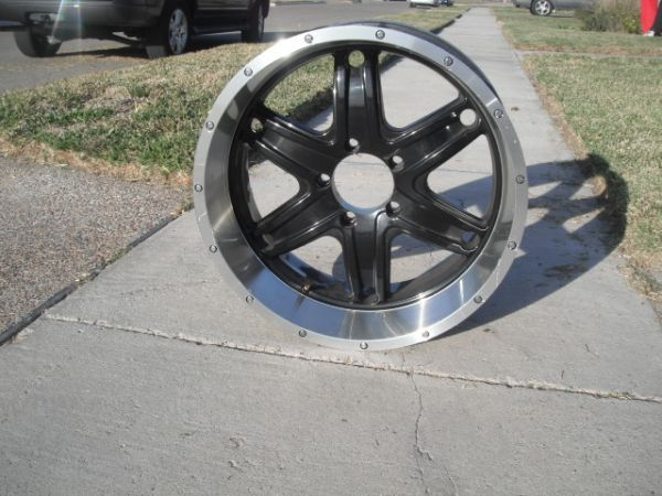 4 rims three tires 20 inch black and chrome five lug rims andtires$400 - $400 (Alice)