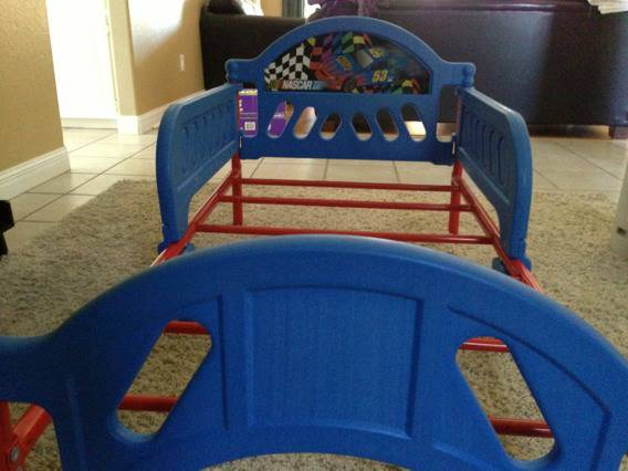 NASCAR Toddler bed with Sealy crib mattress - $25 (South side )