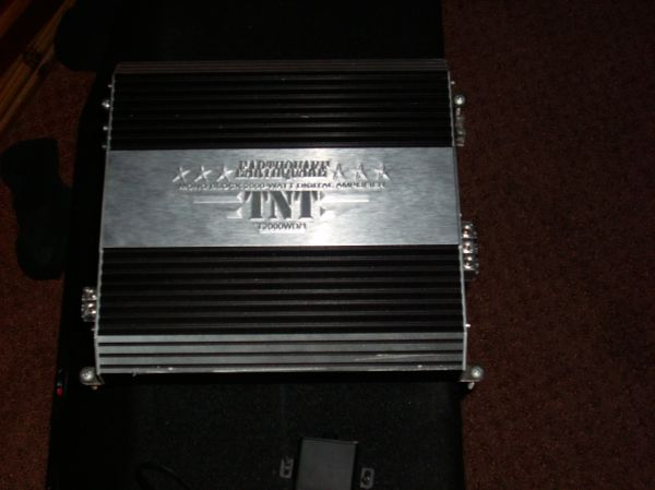 Two 12 xplod and an EarthQuake Amp - $200 (Subwoofer and Amp)