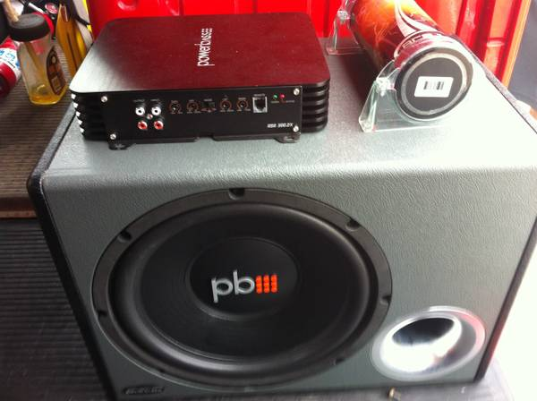 12 inch powerbass sub in box, matching 600 watt  and capacitor.   - $300 (Flour bluff )