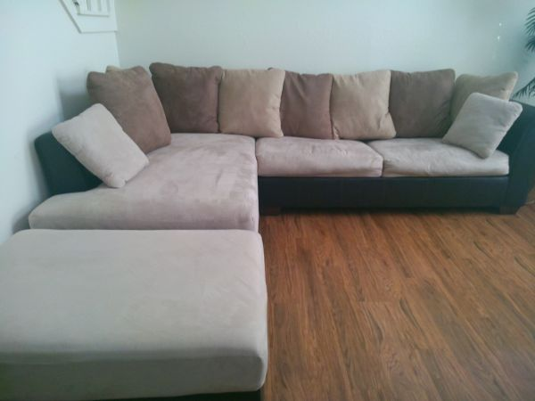 NEW L-SHAPED COUCH - $1600 (LONGVIEW)