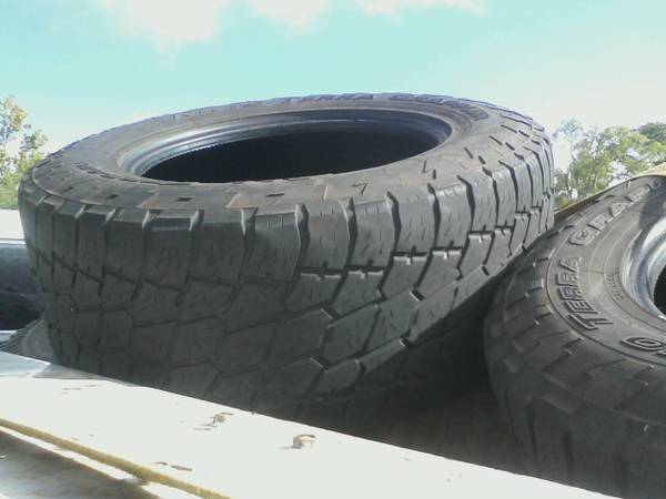 2 Nitto Grapplers 325x60x20, 2 BF Goodrich 305x65x17, 1-16.9 Tractor  - $40 (Longview)