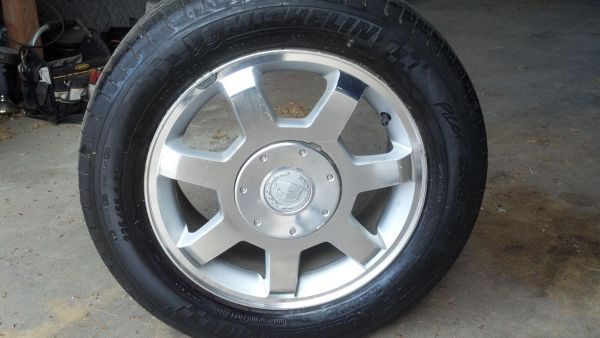 OEM Cadillac wheels and tires - $280 (tyler)