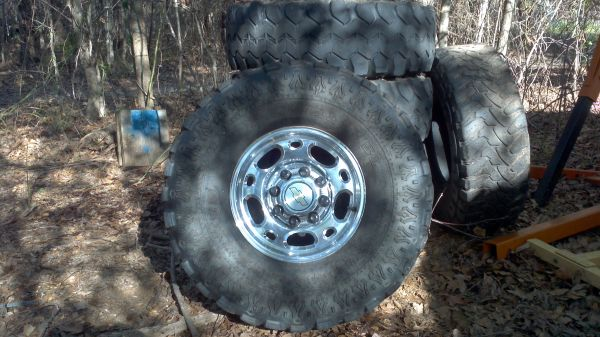 Alluminum 8 lug chevy wheels w 35 tires - $300 (Marshall)