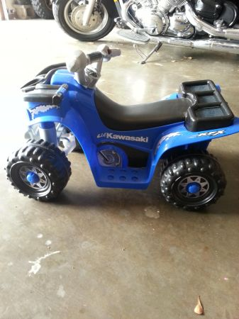 Toddlers battery operated 4 wheeler kawasaki - $75 (Kilgore)