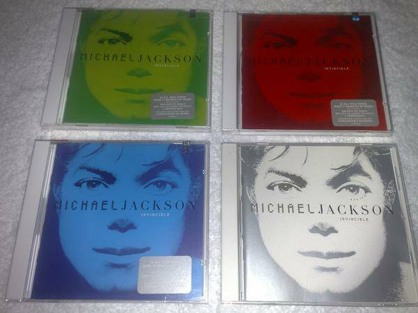 Michael Jackson Invincible 4 cds colors -   x0024 250  Carolina  PR