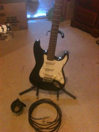 Fender Squier Stratocaster w stand, strap  cord - $175 (Greenville, TX)