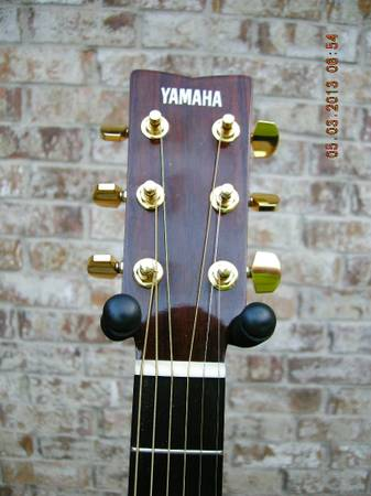 YAMAHA ACOUSTIC GUITAR WITH CASE - $110 (TYLER)