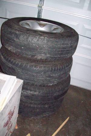 4 TRUCK TIRES AND RIMS FOR A TOYOTA TACOMA GOOD CONDITION CHEAP - $150 (Texas City)