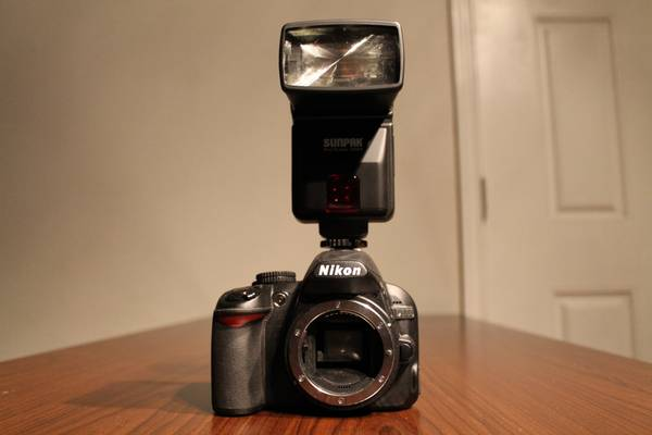 Nikon D3100 (body only) with Sunpak Digiflash 3000 - $250 (1960 and TC Jester)