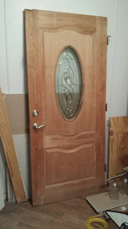 unfinished solid wood entry door with oval glass  -   x0024 400  Houma  LA