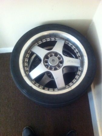 Rsx universal 5 logs rims wit tires 2 tires good conditions 2 soxo oll 400 call - $400 (New Orleans )