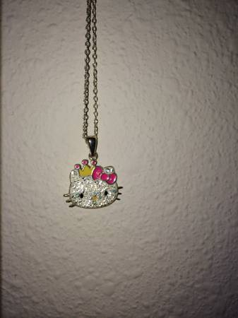 Hello kitty necklace  -   x0024 100  Hwy 290 and 1960