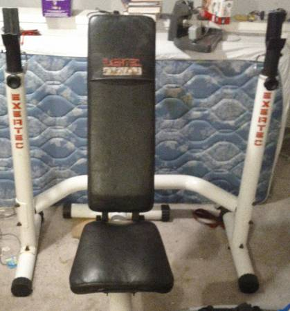 Well over 300lb olympic weight set, w two 45lb bars, bench and more - $250 (Nw Houston 290 bingle)