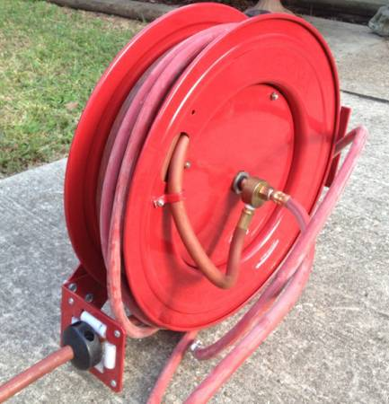 NEW Auto retracting Air Hose Reel w 50 of 300 psi hose - $60 (Conroe)