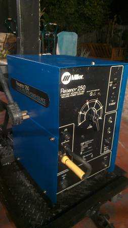 Miller Regency 250 welder with cart - $900 (hobby aiirport)
