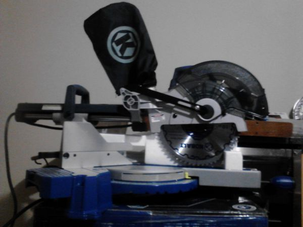 Kobalt 10in sliding compound miter saw w laser new in box - $150 (Houston)