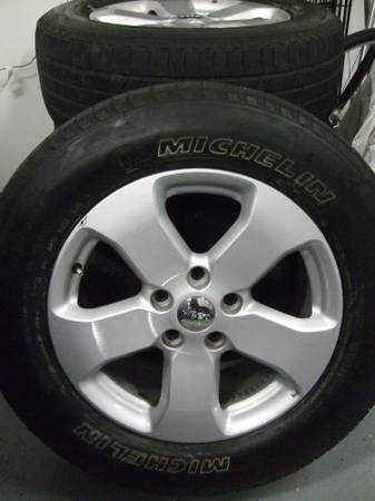 Four (4) 18, 2011 Jeep Grand Cherokee rims and tires. - $400 (Cypress)