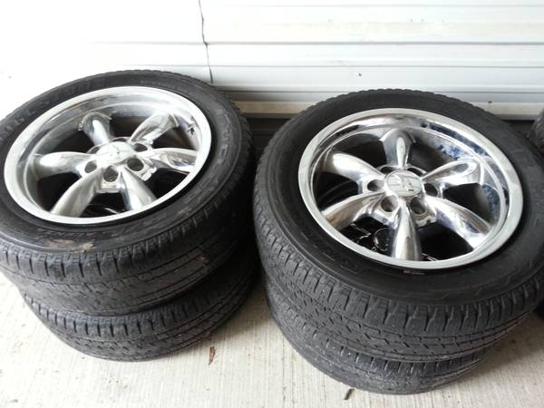 20 in OEM Chevy stock bullet rims and tires - $900 (Houston, Tx.)