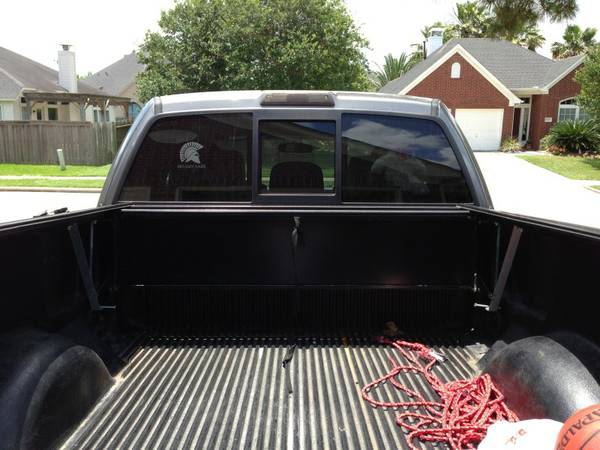 Ford f150 65 aluminum bed cover - $500 (Pearland)
