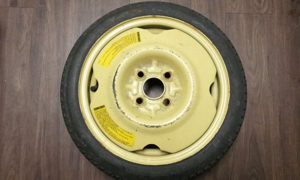 Compact spare wheel and tire combo DONUT 4x100 - $10 (North Houston FM1960)