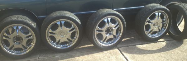 4 18 INCH RIMS 5 TIRES UNIVERSAL LUG PATTERN CAME OFF A BUICK LESABRE  - $300 (HOUSTONMISSOURI CITY)