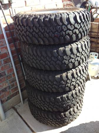 5 x 17 JEEP WRANGLER RUBICON WHEELS RIMS TIRES STOCK OEM FACTORY - $450 (Tomball, TX)
