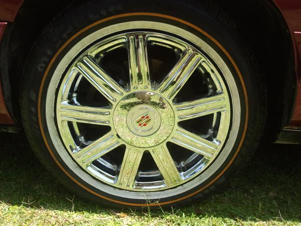 17 inch cadillac rims with vouges - $700 (Easthouston)