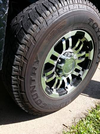 Tires 2657017 Toyo open country ATs w Chevy 8 lug wheels - $725 (Lake Jackson)