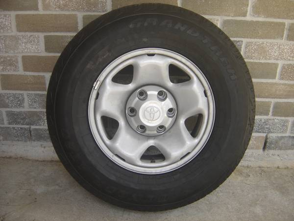 Toyota Tacoma wheels (rims and tires) - $140 (Nw houston)