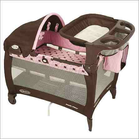 brown and pink graco pack and play - $65 (n.w)